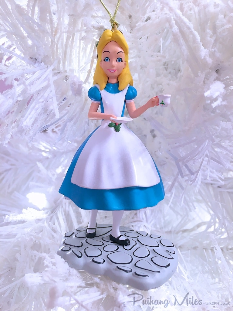 Alice holding a teacup